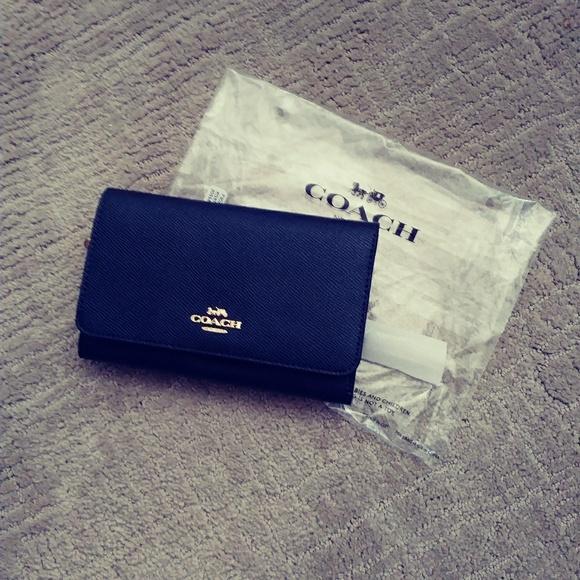 Coach Handbags - ❤ Coach Flap Phone Wallet ❤